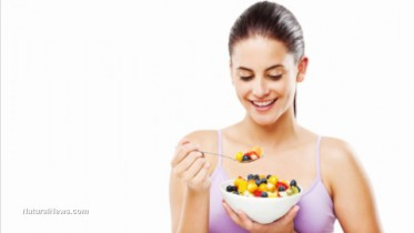 Young-Woman-Eating-Fruits-Healthy-Diet-Nutrition
